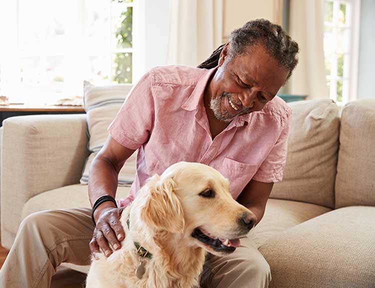 Elderly Man with Healthy and Happy Dog